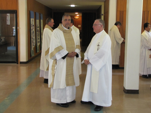 Prior to ceremony Fr Art Flores, OMI chats with Fr. Jim Allen, OMI