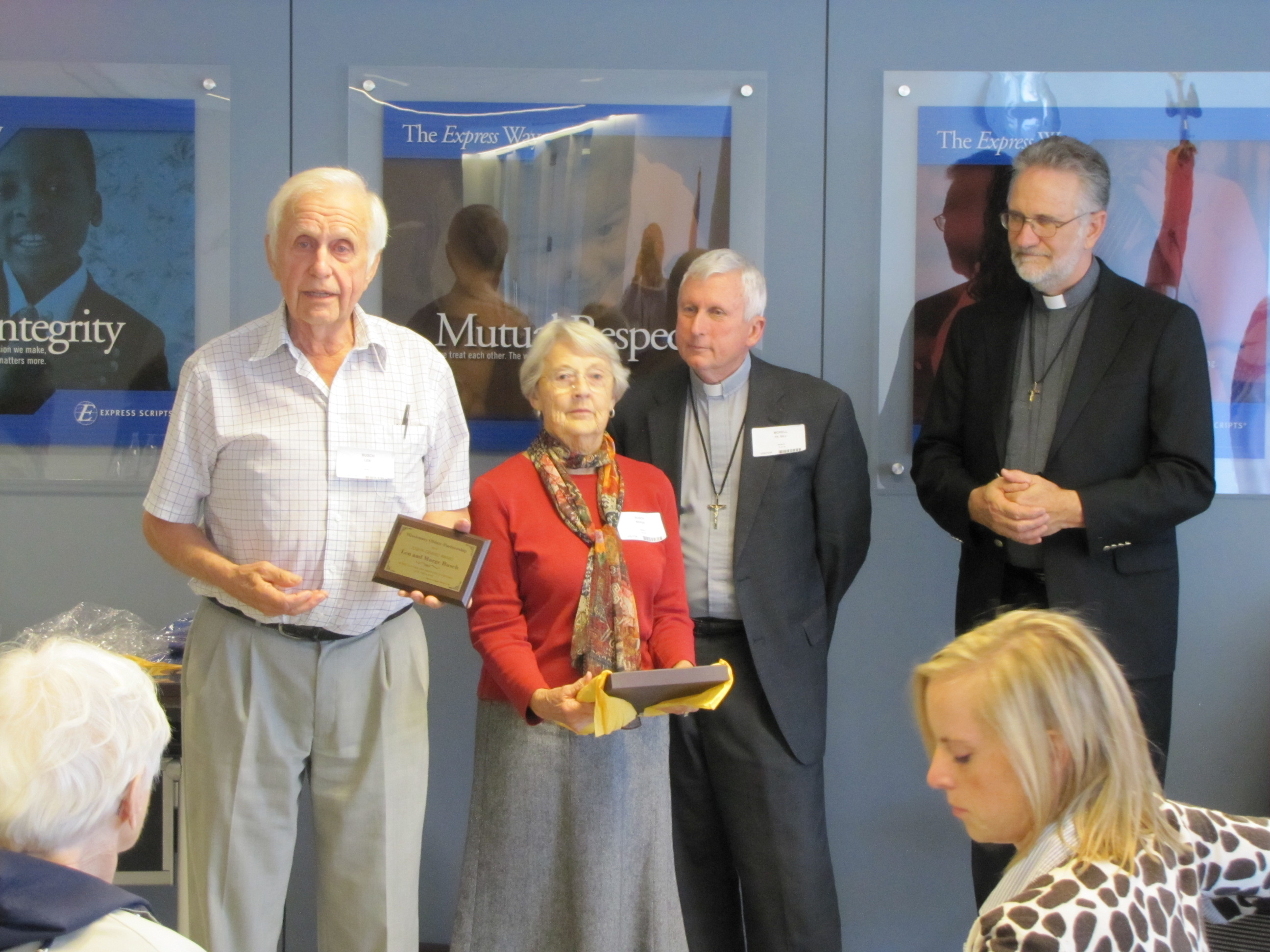 L-R Len and Marge Busch receive Gerard Award from Fathers Bill Morell and Bill Antone.
